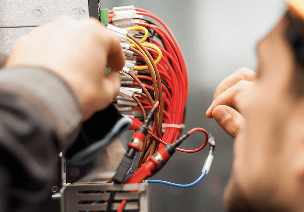 Worker checking wiring